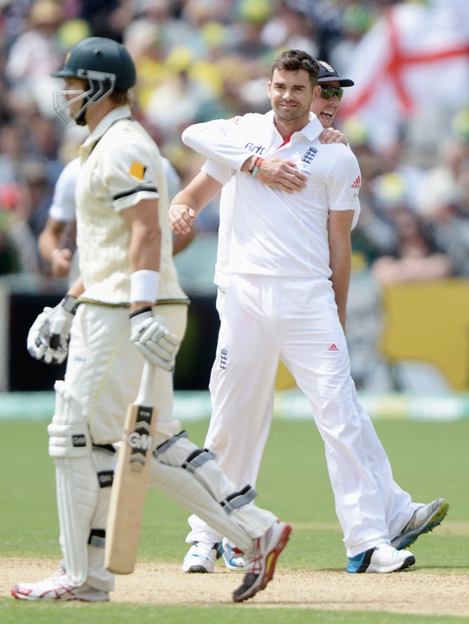 James Anderson of England celebrates with Graeme Swann after dismissing Shane Watson of Australia