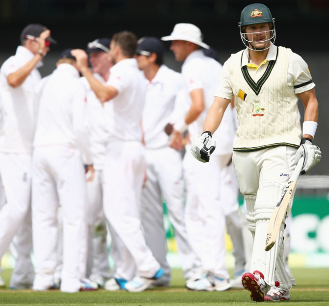 Shane Watson of Australia walks from the ground after he was dismissed by James Anderson