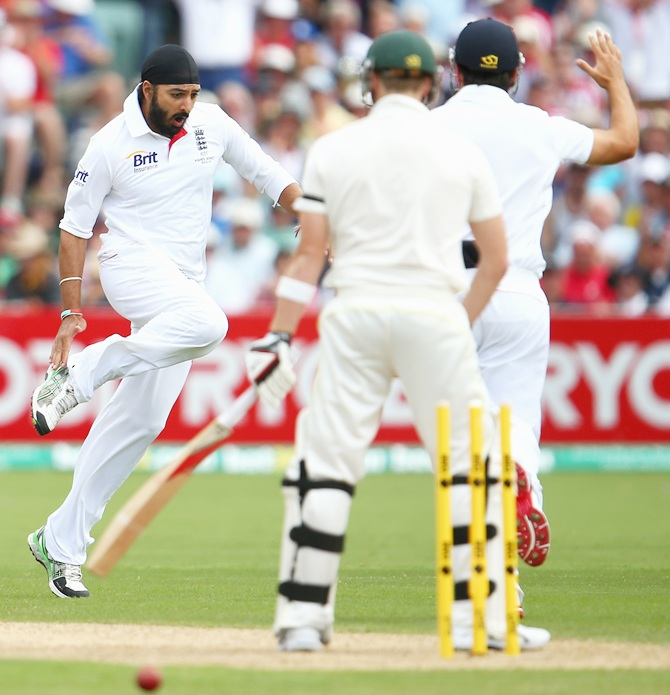 Monty Panesar of England celebrates after taking the wicket of Steve Smith of Australia