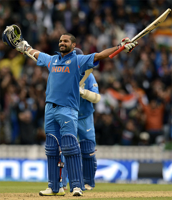 India's Shikhar Dhawan celebrates as he reaches his century during the ICC Champions Trophy
