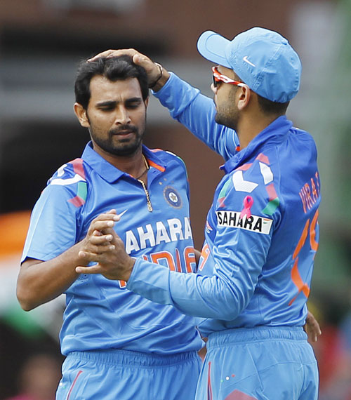 India's Mohammed Shami is congratulated by Virat Kohli (right) after getting out South Africa's Jacques Kallis
