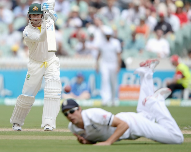 Australia captain Michael Clarke hits the ball past England captain Alastair Cook