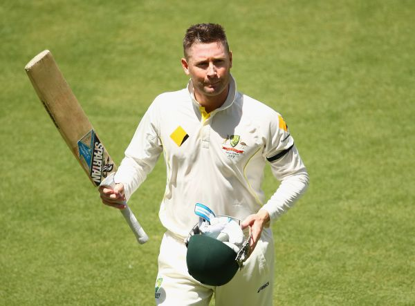 Michael Clarke walks back after being dismissed