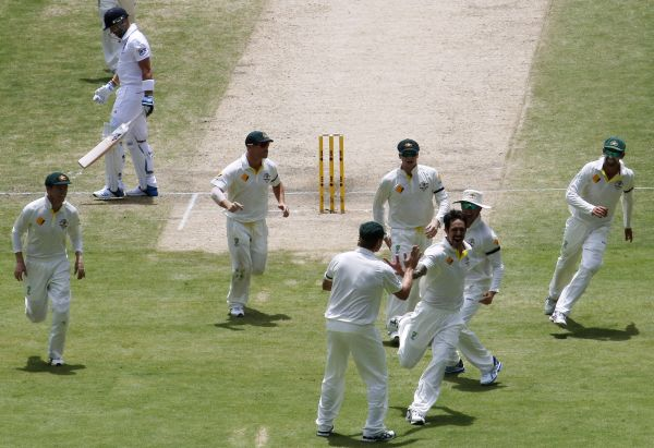 Australia's Mitchell Johnson (3rd R) celebrates with teammates after taking the wicket of England's Matt Prior