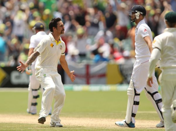 Mitchell Johnson of Australia looks at James Anderson of England after bowling him out