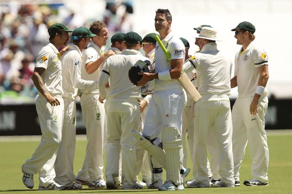 Kevin Pietersen of England leaves the field after getting out as Australian players celebrate