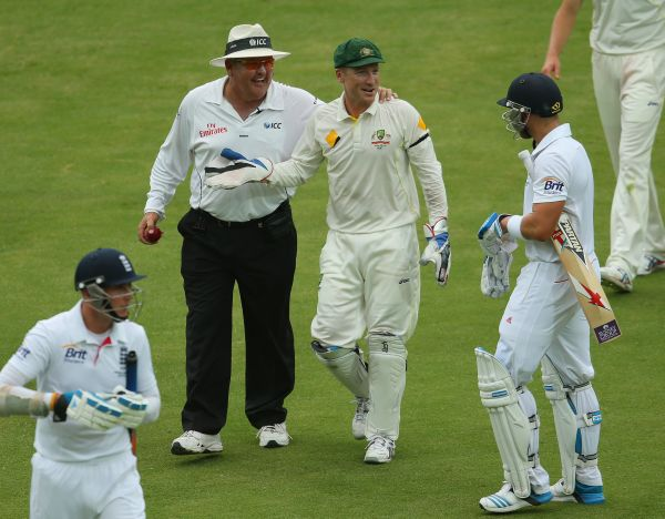 Matt Prior of England and Brad Haddin of Australia exchange words as umpire Marais Erasmus looks on