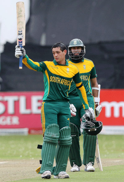 Quinton de Kock celebrates his hundred as Hashim Amla looks on