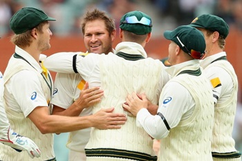 Ryan Harris of Australia is congratulated by team mates