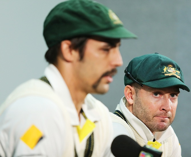 Mitchell Johnson and Michael Clarke of Australia