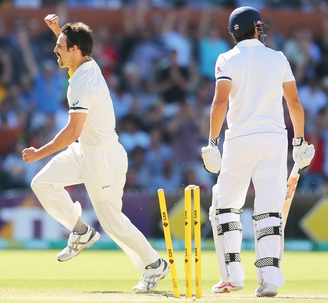 Mitchell Johnson of Australia celebrates after dismissing Alastair Cook