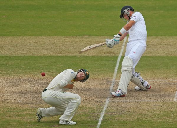Joe Root of England plays a pull shot as George Bailey of Australia ducks