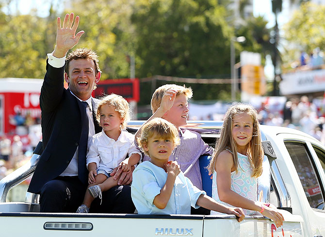 Adam Gilchrist of Australia does a lap of the ground with his children after being inducted into the ICC's Hall of Fame on Friday