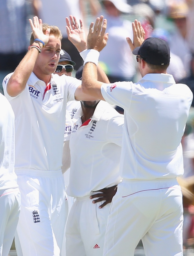 Stuart Broad of England is congratulated by James Anderson after taking the wicket of Mitchell Johnson of Australia