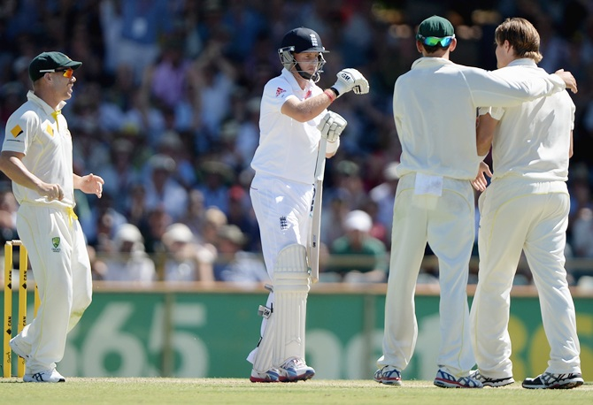 Joe Root of England reviews his wicket after Shane Watson of Australia dismisses him