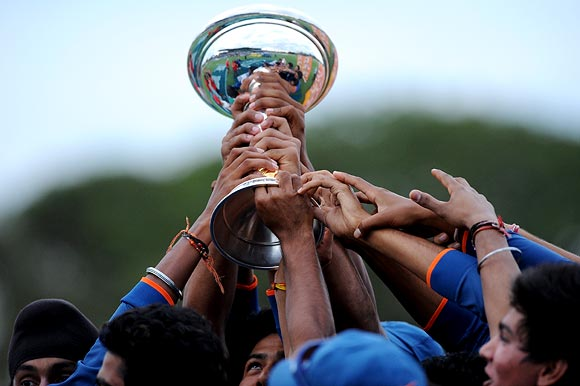 The Indian players celebrate with the Under-19 World Cup trophy
