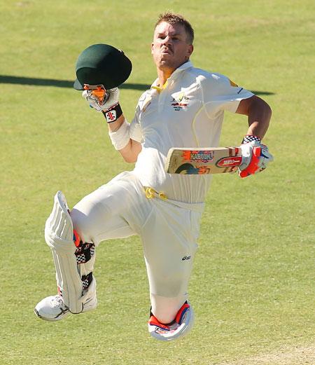 David Warner of Australia celebrates reaching his century