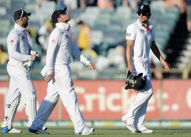 England captain Alastair Cook leaves the field alongside Matt Prior and Ian Bell