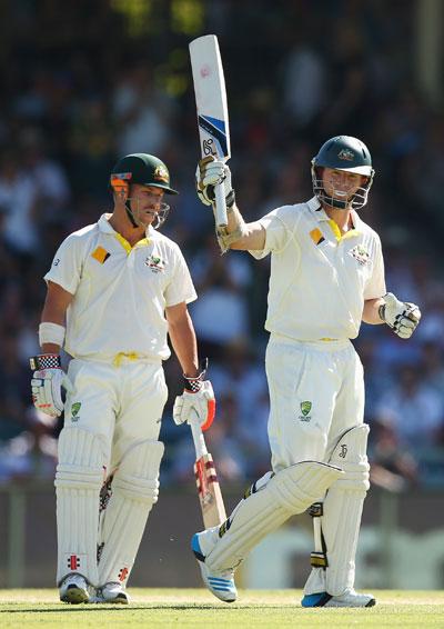 Chris Rogers of Australia raises his bat after scoring his half century