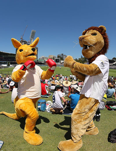An Australian kangaroo mascot and English Lion mascot pose