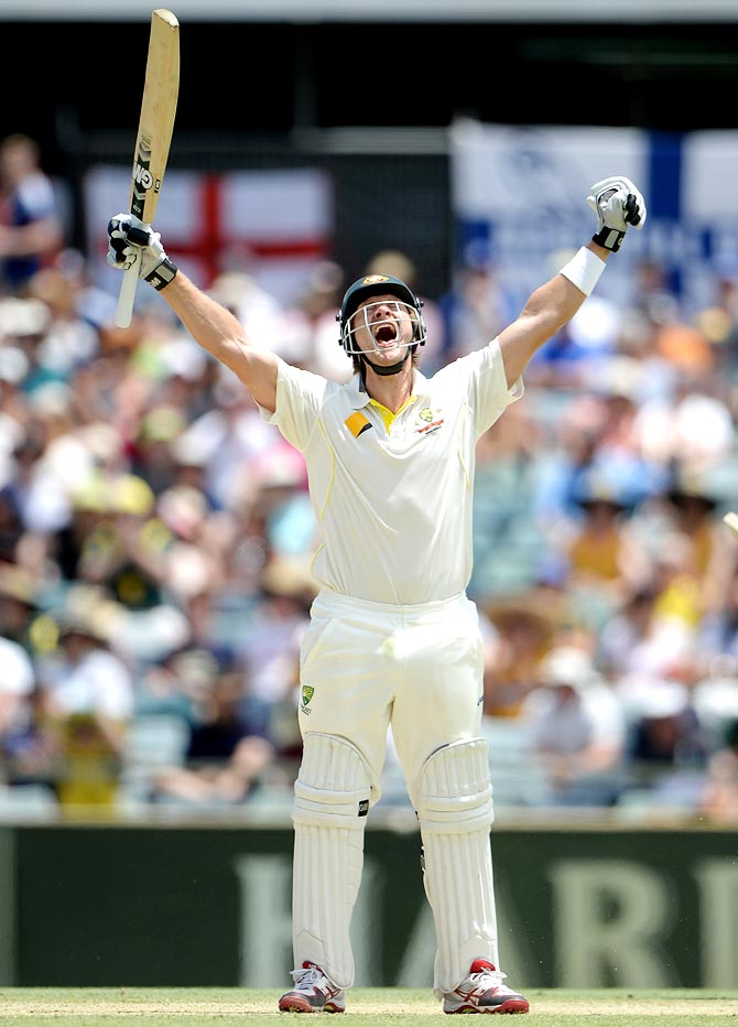 Shane Watson celebrates after completing his century