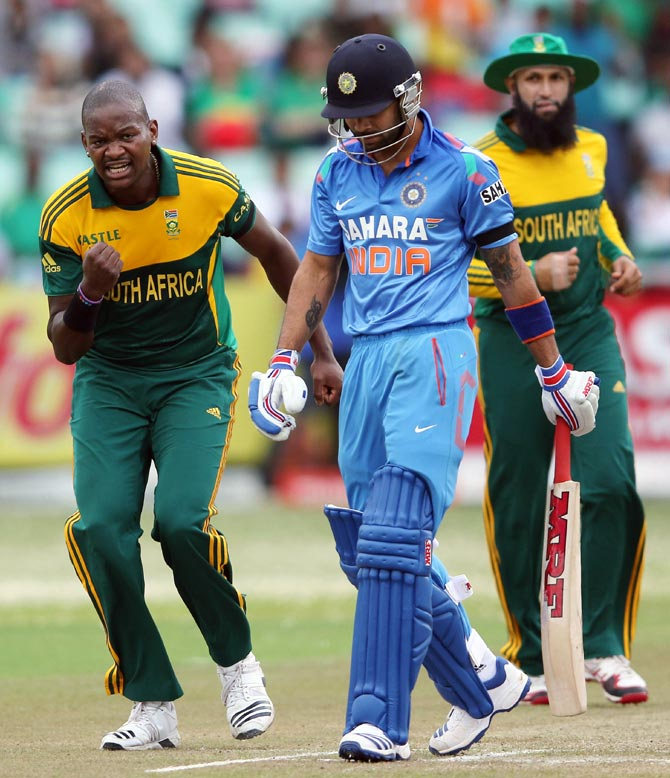 Lonwabo Tsotsobe celebrates after taking the wicket of Virat Kohli