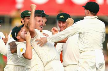 Peter Siddle celebrates after taking the wicket of Ian Bell