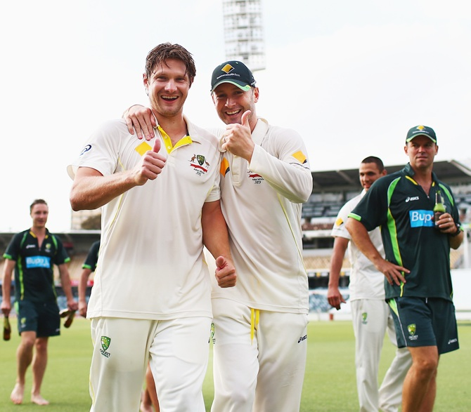 Michael Clarke and Shane Watson of Australia celebrate on the pitch