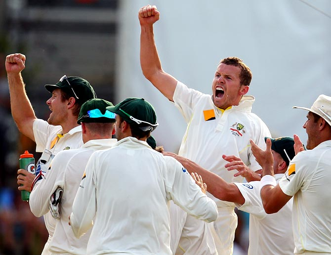Peter Siddle (centre) celebrates with his teammates