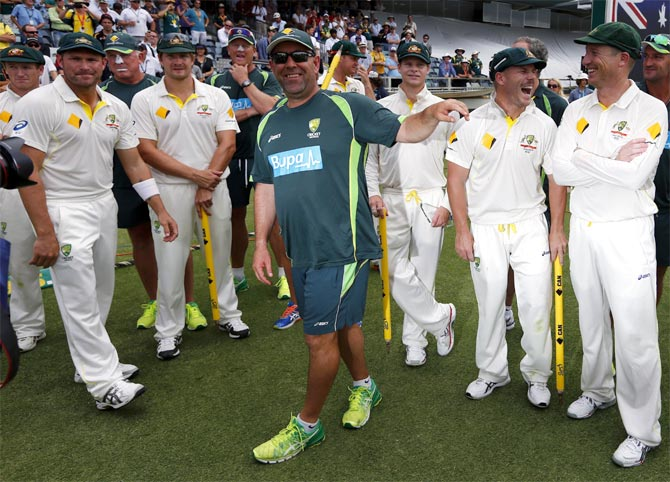 Australia's coach Darren Lehmann (centre) jokes with his players after winning the Ashes in Perth