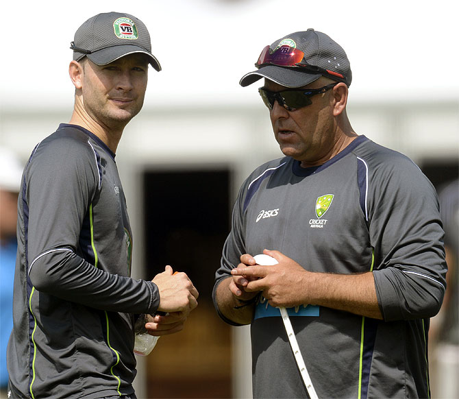 Australia's captain Michael Clarke (left) talks to coach Darren Lehmann during a training session