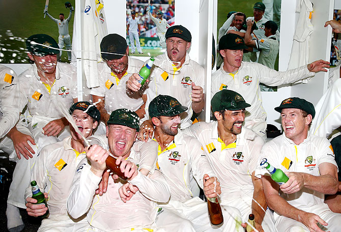 The Australian team celebrates victory in the change rooms after winning the Third Ashes Test Match and the Ashes at WACA in Perth on Tuesday