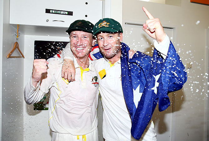 Brad Haddin and Michael Clarke of Australia celebrate victory in the dressing room on Tuesday