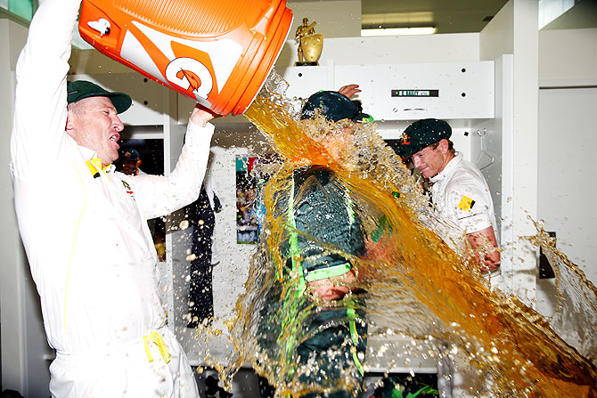 Brad Haddin of Australia tips a gallon of beer on coach Darren Lehmann in the dressing room on Tuesday