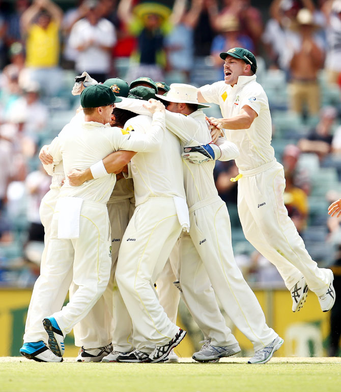 David Warner of Australia and the Australian team celebrate victory on Day 5 of the Third Ashes Test at WACA in Perth on Tuesday