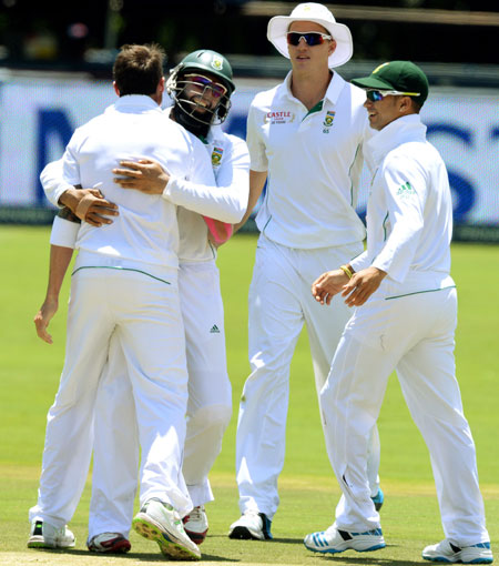 Dale Steyn of South Africa celebrates the first wicket
