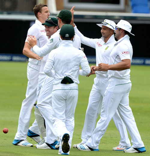 Morne Morkel of South Africa celebrates the wicket of MS Dhoni