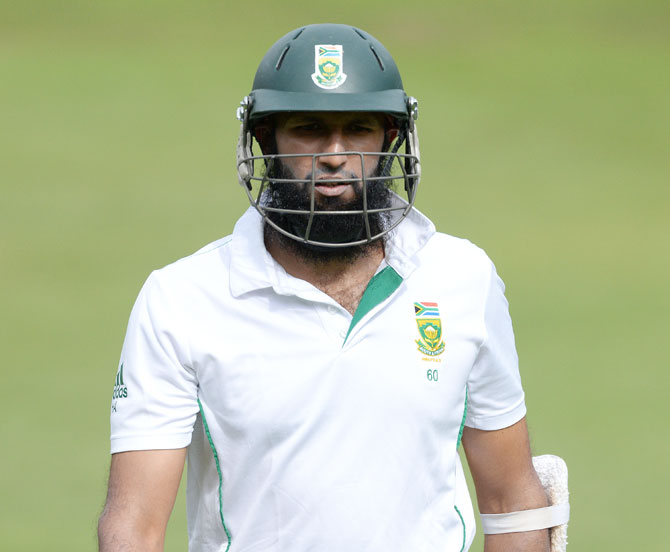 Hashim Amla of South Africa walks off after being dismissed by Ishant Sharma