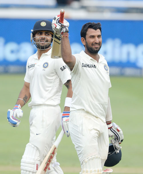 Cheteshwar Pujara of India celebrates his 100