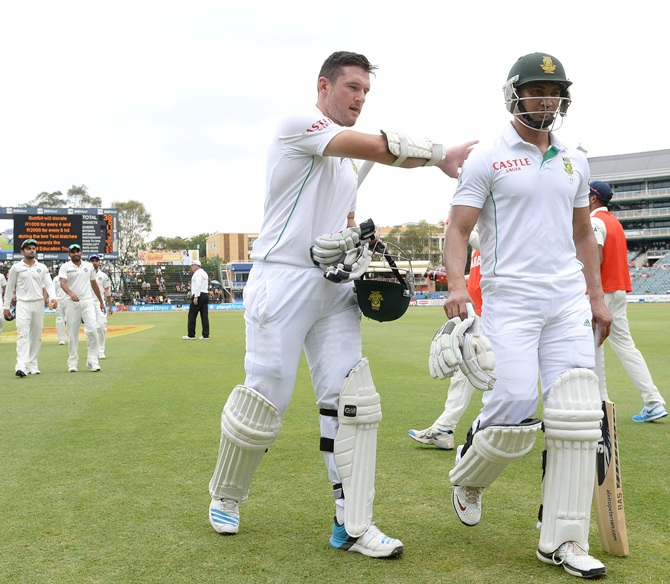Graeme Smith and Alviro Petersen of South Africa walks off at tea during day 4 of the 1st Test match