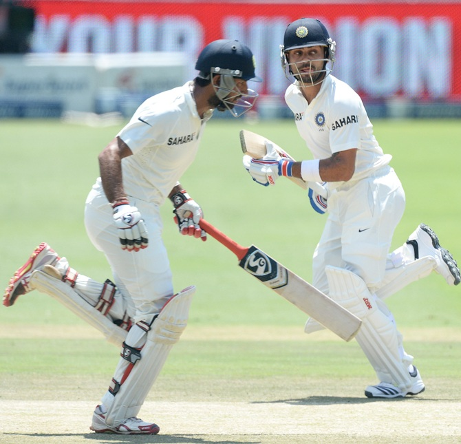 Cheteshtar Pujara and Virat Kohli (right)