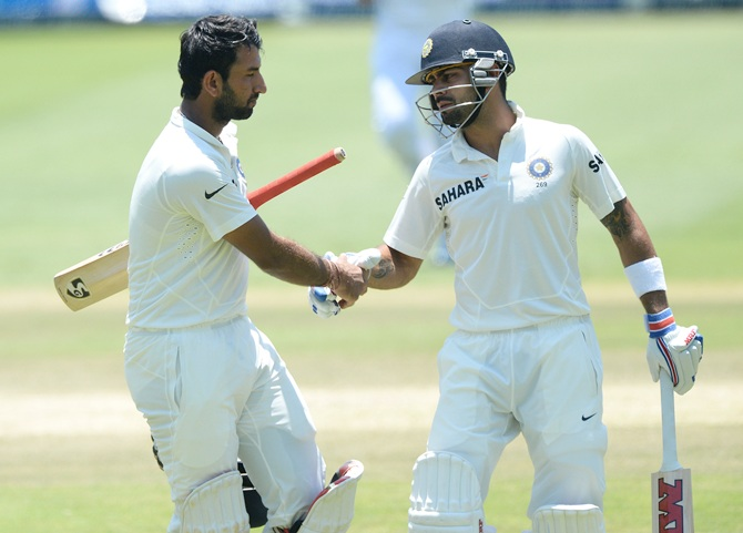Virat Kohli (right) with Cheteshwar Pujara