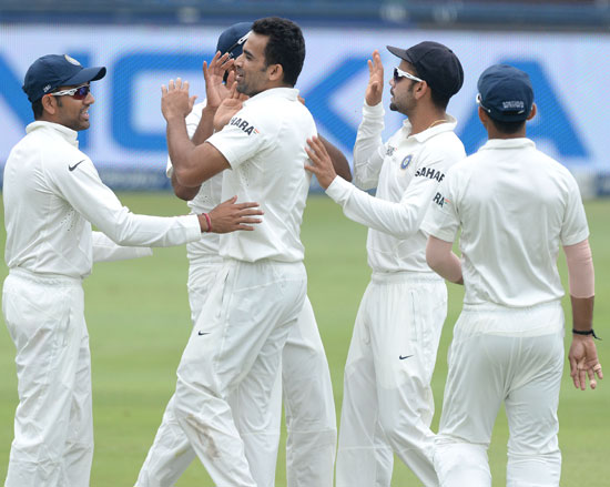 Zaheer Khan is congratulated by teammates after taking a wicket