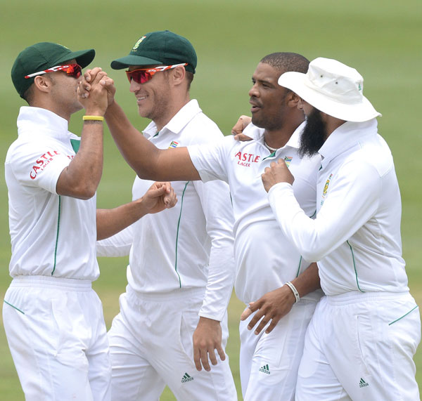 Vernon Philander is congratulated by his teammates