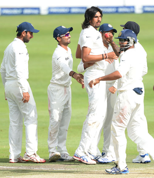 Ishant Sharma is congratulated by teammates after taking a wicket