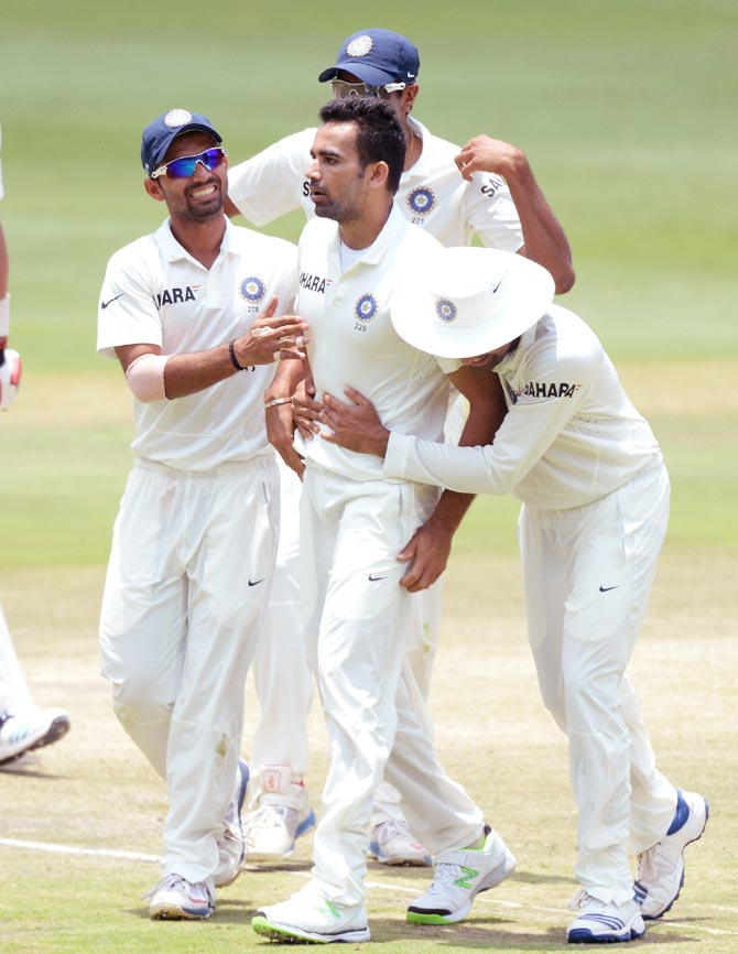 Zaheer Khan (centre) celebrates a wicket with his team mates