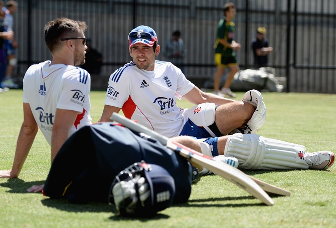 England captain Alastair Cook speaks with James Anderson during an England nets session at Melbourne Cricket Ground