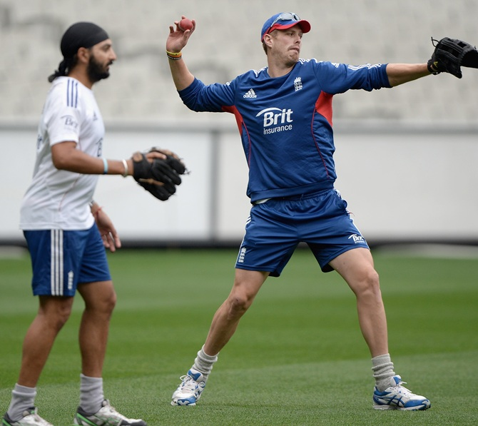 Boyd Rankin and Monty Panesar of England take part in a fielding drill during a nets session