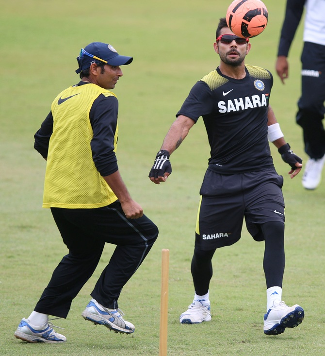 Mohammed Shami (left) and Virat Kohli of India play football during the Indian national cricket team training s