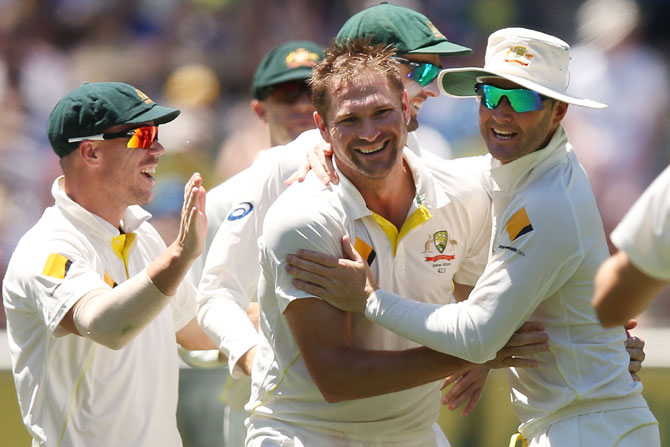 Ryan Harris of Australia celebrates his dismissal of Joe Root of England with teammates